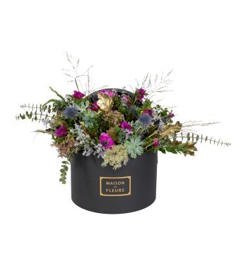 Festive Collection Fresh winter arrangement with greenery and Purple Anemones in a 30 cm black round box