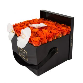 3 White Orchid Blooms and Orange Roses in Black Square box