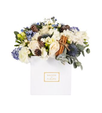 Festive mix of fresh flowers with cinnamon stick in a 15x15 cm White square box
