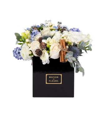 Festive mix of fresh flowers with cinnamon stick in a 15x15 cm Black square box