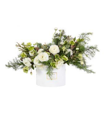 Winter arrangement with White Ranunculus and Helleborus in a 20x15 cm White round box